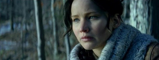 Jennifer Lawrence as Katniss in the grey forests of District 12