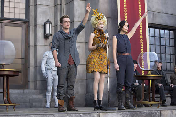 Josh Hutcherson, Effie Trinket and Jennifer Lawrence address District 12